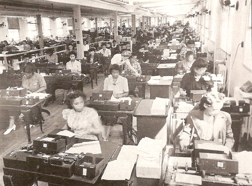 1942_War_Dept_card_punching_section_WP_DCPL All the women punching cards are African American. The supervisor in the aisle is white.